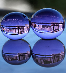 two bubbles reflecting city scene
